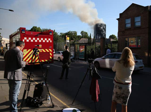Emergency services and media at the scene of the fire (Steve Paston/PA)