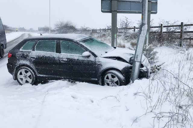 A car which left a slip road off the A30 near Okehampton in Devon (Martin Keene/PA)