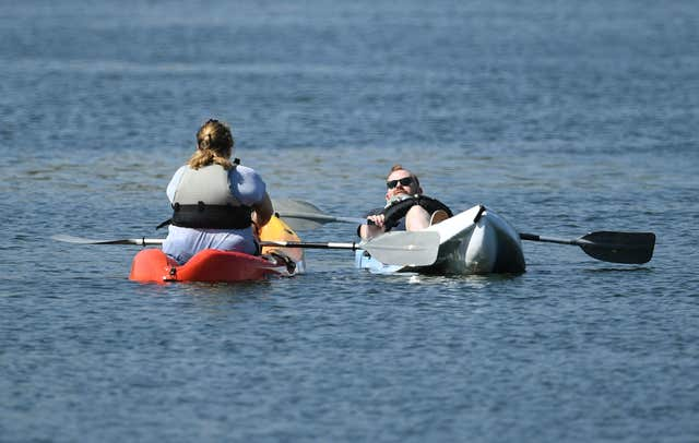 People relax on kayaks at Nene Park in Peterborough