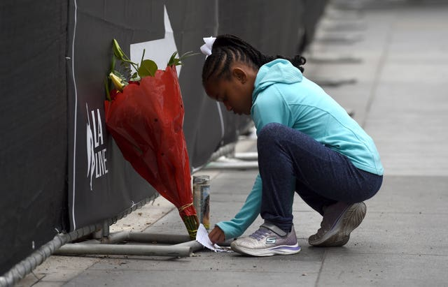 Dharma Brown, an eight-year-old, paid her respects