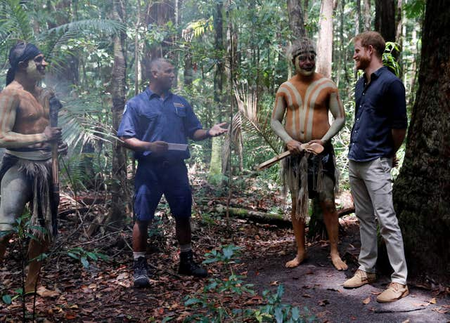 The Duke of Sussex stands next to Butchulla People during a dedication ceremony of the forests of K'gari to the Queen's Commonwealth Canopy on Fraser Island (Phil Noble/PA)