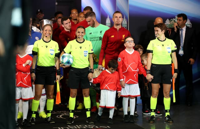 Match Officials Manuela Nicolosi, Stephanie Frappart and Michelle O'Neill lead out the teams