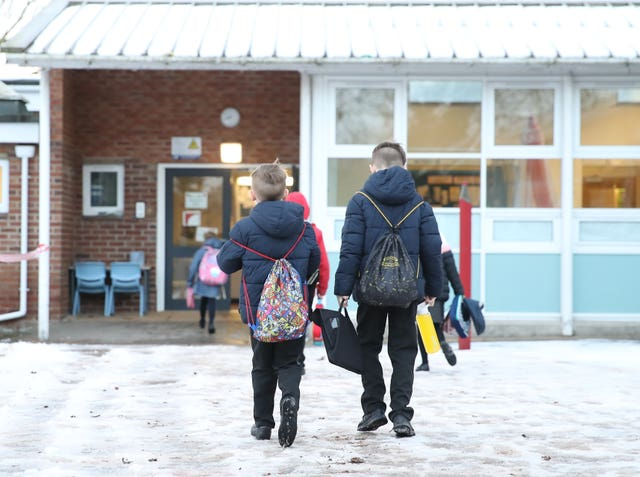 Children arrive for school