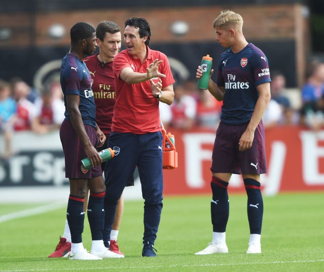 Emery gives instructions to Maitland Niles, left, during a pre-season friendly