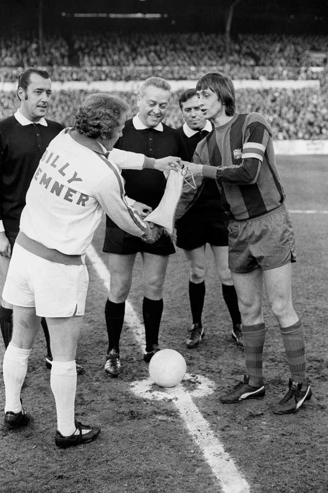 Barcelona captain Johan Cruyff (right) swaps pennants with Leeds captain Billy Bremner before the European Cup semi-final, first leg clash between the sides in April 1975