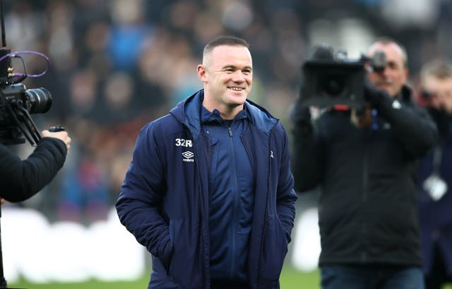 All eyes on me - Rooney poses for the television cameras