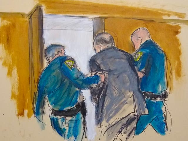 In this courtroom sketch Harvey Weinstein is led out of Manhattan Supreme Court by court officers