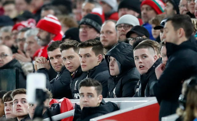 James Milner, left, watched on at Anfield