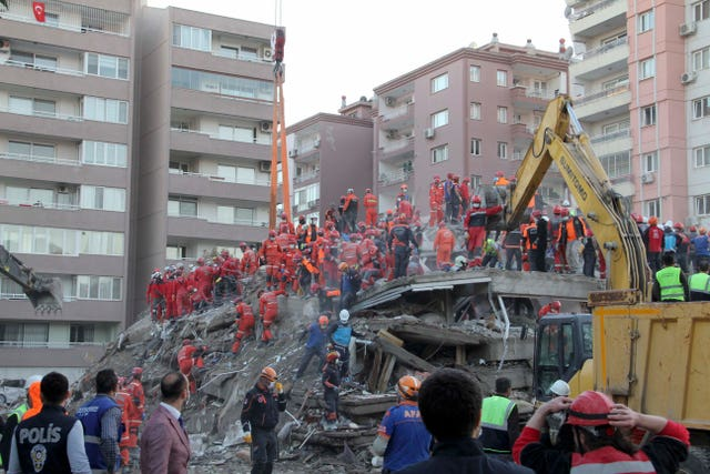 Rescue workers trying to reach survivors trapped in rubble in Izmir