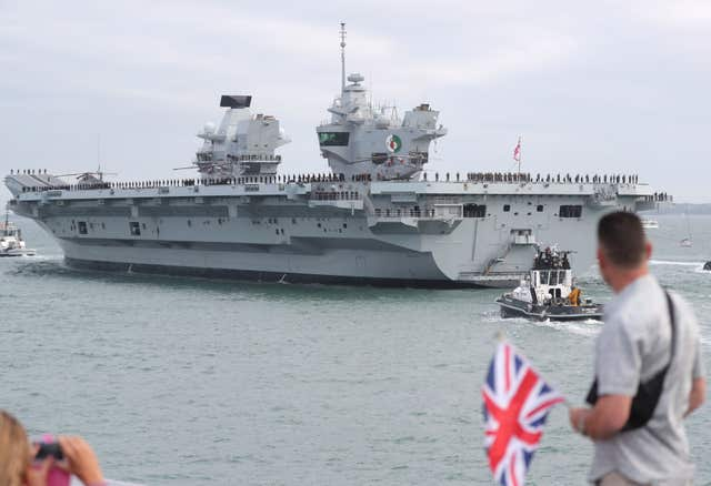 HMS Queen Elizabeth will deploy to the Middle East and Pacific on her maiden operational mission (Steve Parsons/PA)