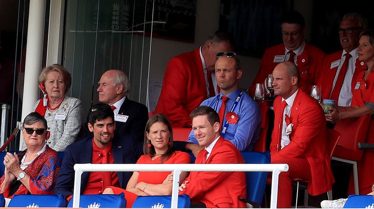 Eoin Morgan and Alastair Cook were among those to don red in honour of the Ruth Strauss foundation