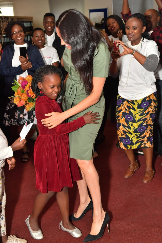 The duchess hugs eight-year-old Luyanda
