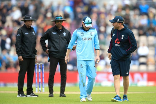 England captain Eoin Morgan leaves the field in pain.