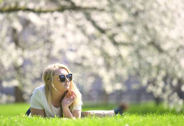 Soaking up the rays in London's Green Park (Victoria Jones/PA)