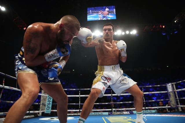 Tony Bellew, left, was beaten in eight rounds by Oleksandr Usyk at Manchester Arena