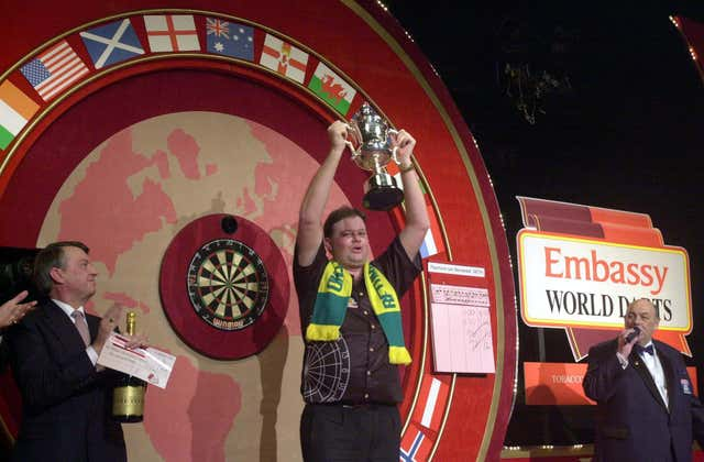 Raymond Van Barneveld celebrates with the trophy after winning the 2003 world title against Ritchie Davies
