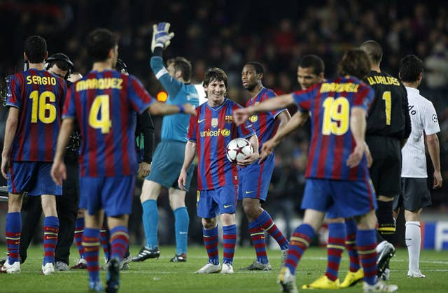 Lionel Messi, centre. with the match ball after scoring four against Arsenal