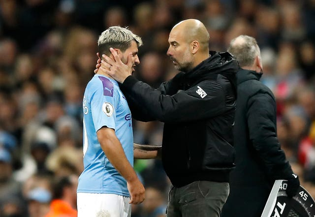 Sergio Aguero, left, appears in pain after being substituted against Chelsea on Saturday