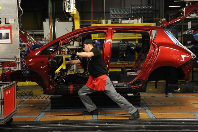 A car being made in a factory