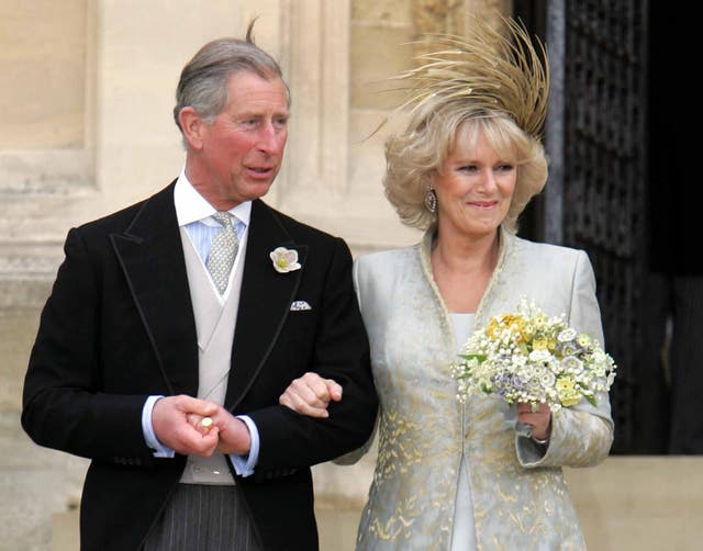 The Prince of Wales and his bride the Duchess of Cornwall leave St George's Chapel (PA)
