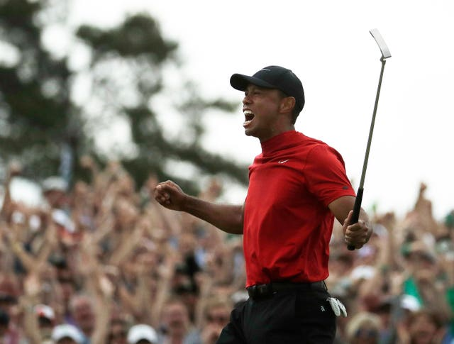 Tiger Woods reacts as he wins the Masters golf tournament Sunday, April 14, 2019, in Augusta,