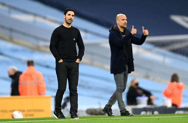 Arsenal manager Mikel Arteta. left, came away empty-handed against his former boss Pep Guardiola