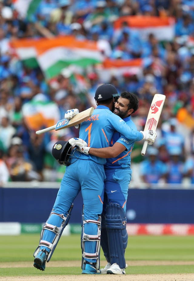 India's Rohit Sharma celebrates his century with team-mate KL Rahul