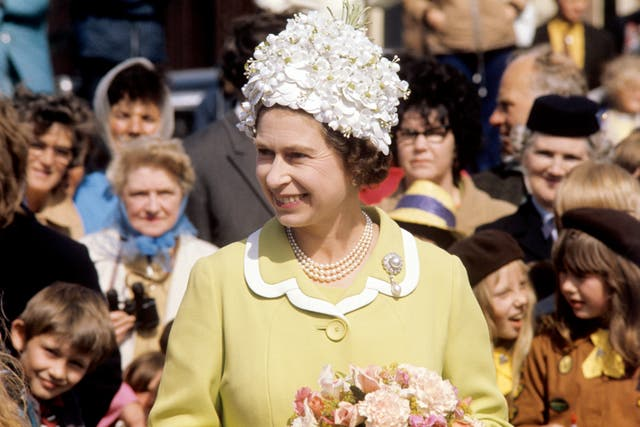 The Queen in a white floral decked hat during her visit to the Isle of Man in 1972 (PA)