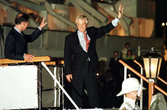 Then-governer of Hong Kong, Chris Patten, alongside the Prince of Wales, leaves on the last day of British rule on June 30, 1997
