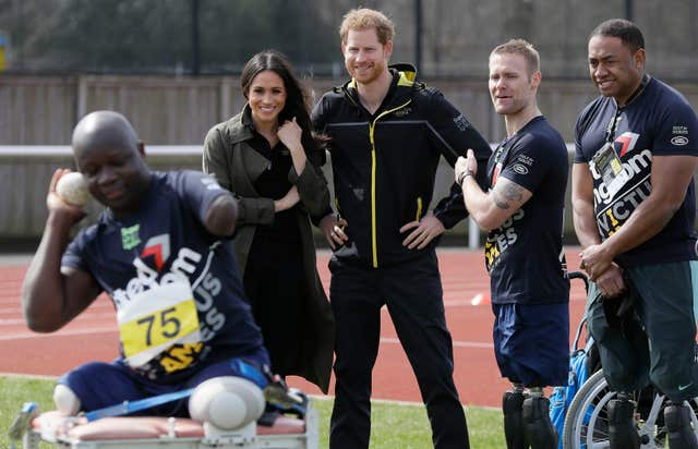 Prince Harry and Meghan Markle meet athletes (Kirsty Wigglesworth/PA)