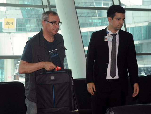 Israeli ambassador to Turkey Eitan Na'eh, left, waits at Ataturk International Airport before his flight to Israel (AP)