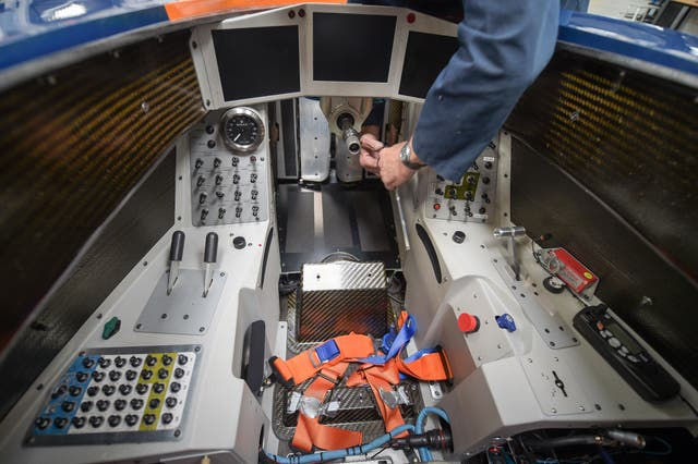 An engineer tightens bolts in the cockpit after fitting a footplate on the BLOODHOUND SSC at the Bloodhound Technical Centre in Avonmouth (Ben Birchall/PA)