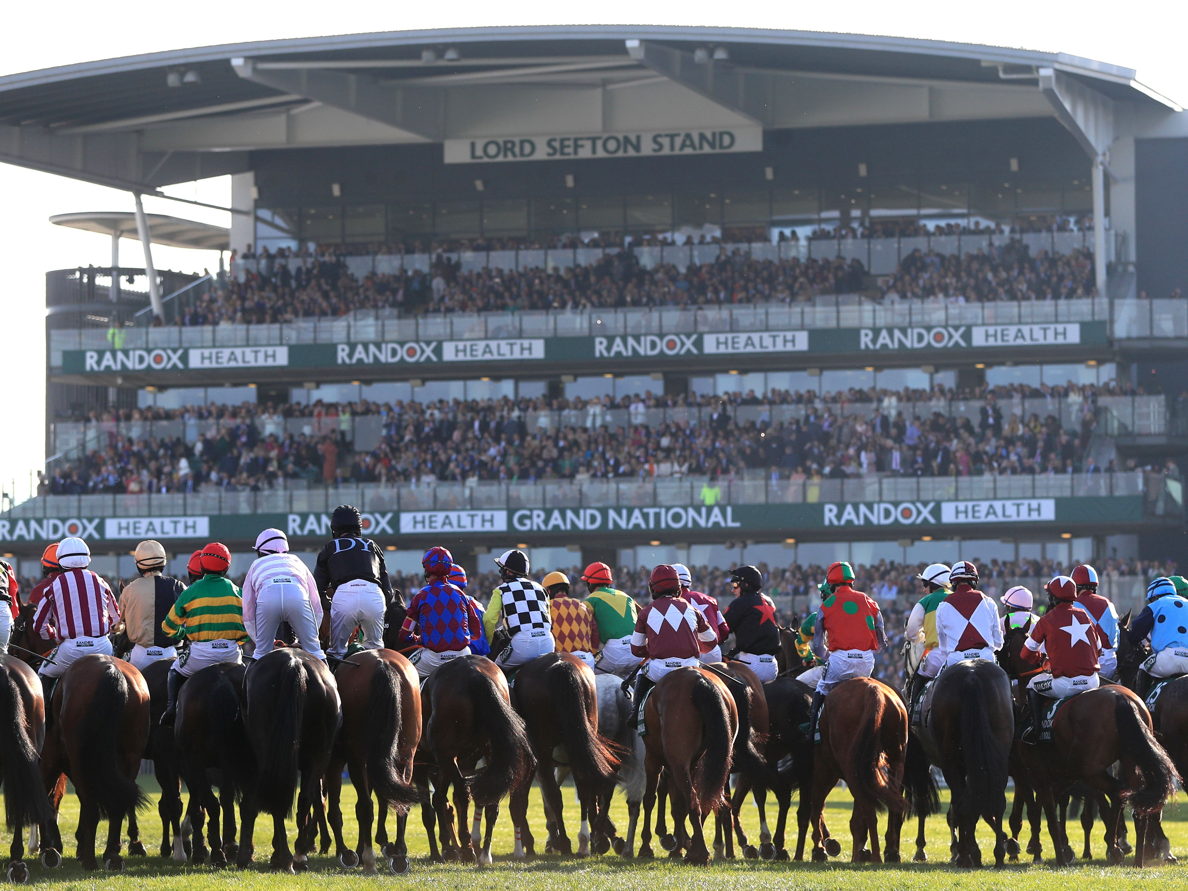 The scene at the start of the Grand National (Mike Egerton/PA)