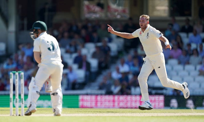 Stuart Broad celebrates taking the wicket of David Warner during day four of the fifth Test