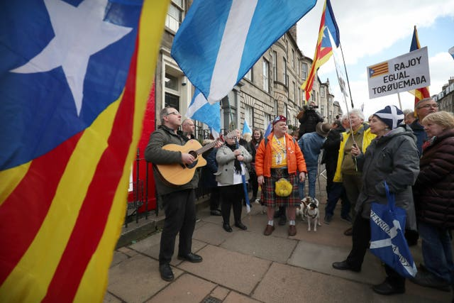 Around 60 people attended the rally (Jane Barlow/PA)