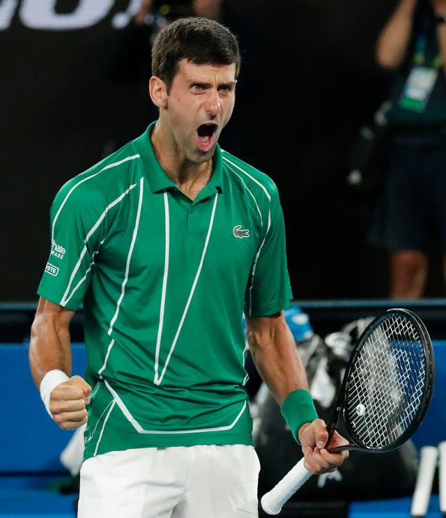 Novak Djokovic roars after his five-set victory over Dominic Thiem