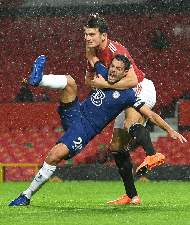 Harry Maguire tussles with Cesar Azpilicueta