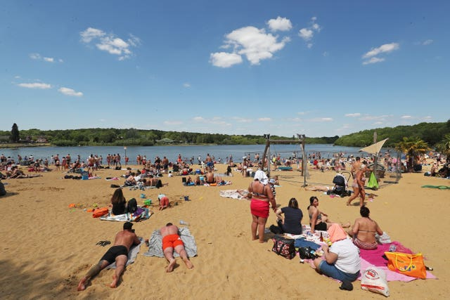 People enjoying the good weather at Ruislip Lido in London (Jonathan Brady/PA)