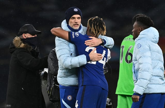 Thomas Tuchel, left, embraces Reece James after the win at Tottenham