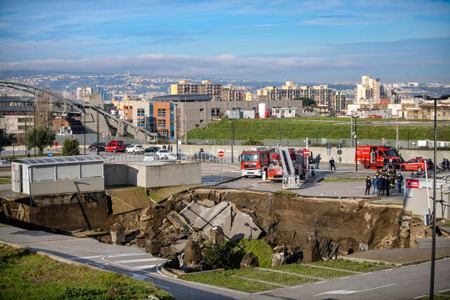 Cars were swallowed up in the sinkhole (Alessandro Pone/LaPresse/AP)
