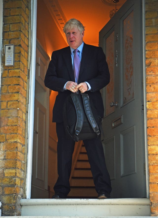 Boris Johnson leaving his home in south London