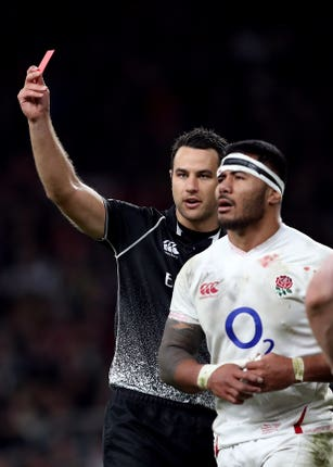 Referee Ben O'Keeffe, left, showed Manu Tuilagi a red card on Saturday for a shoulder-led challenge to the head of George North