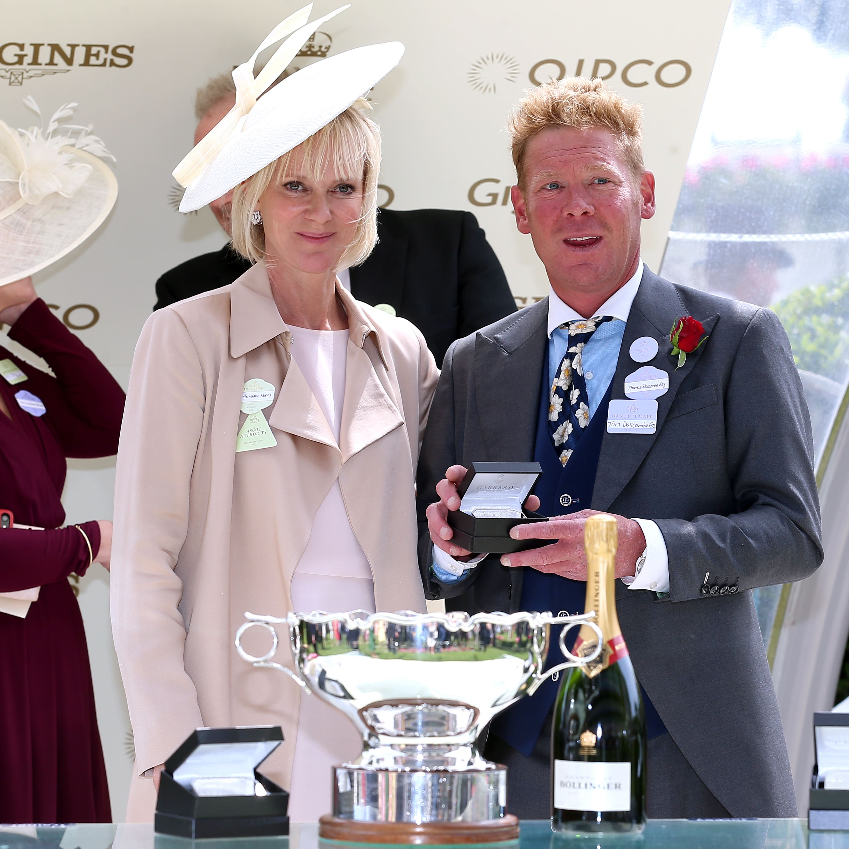 Tom Dascombe receives his prize from presenter Hermione Norris after the victory of Arthur Kitt in the Chesham Stakes at Royal Ascot