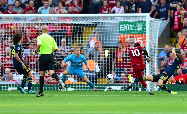 Sadio Mane, second right, shoots from the edge of the box
