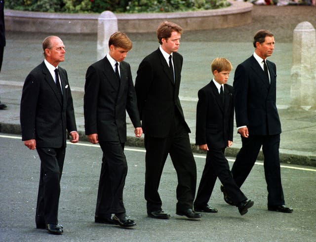 The Duke of Edinburgh joins the Prince of Wales, Prince William, Prince Harry and Earl Althorp to walk behind Diana's funeral cortege