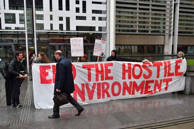 Demonstrators protested against the hostile environment immigration policy outside the Home Office (Dominic Lipinski/PA)