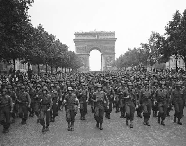 US soldiers march along the Champs Elysees after the liberation of Paris