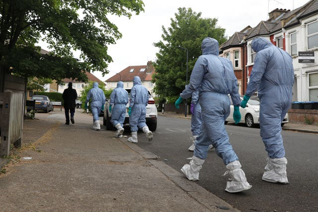 Police forensic officers looking for evidence