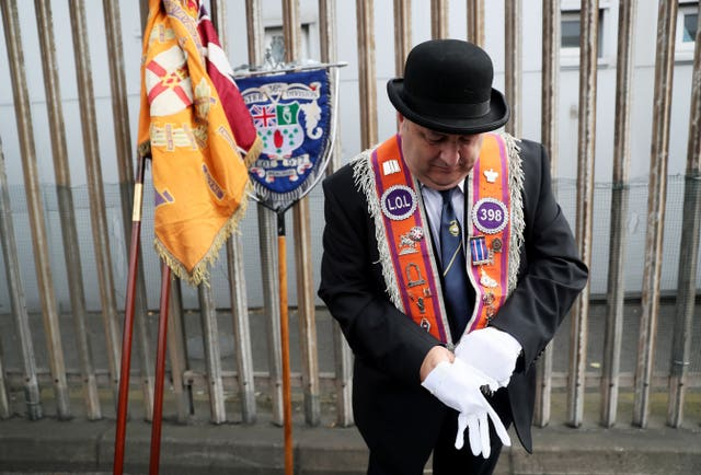 An Orange Order member ahead of a parade in Belfast