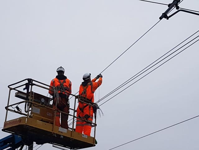 Network Rail  engineers working through the night to try and fix damaged electric power cables between Slough and Paddington (Network Rail/PA)